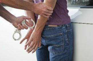 teen-getting-handcuffed325x215